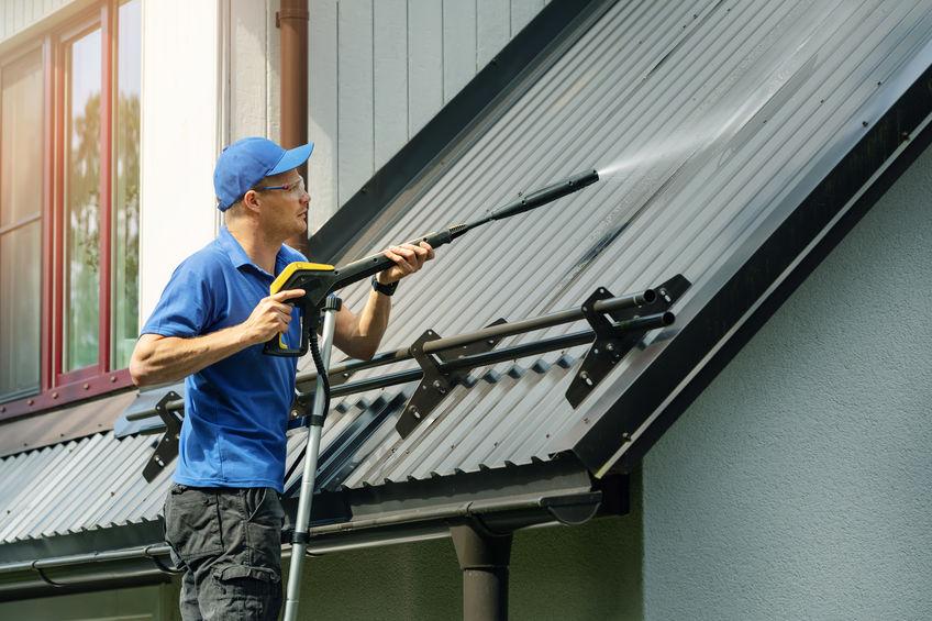 Man Pressure Washing Roof